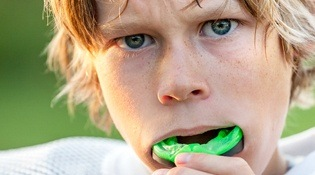 child with athletic mouthguard