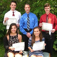 Dr. Cartwright posing with four teen award winners