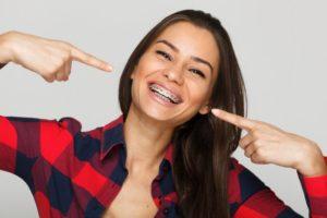 woman smiling wearing metal braces