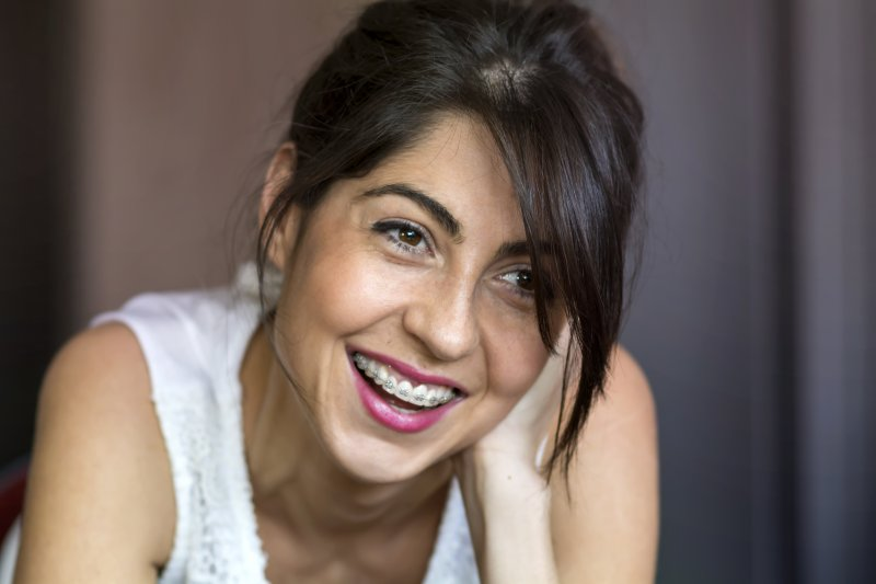 Adult woman smiling with braces